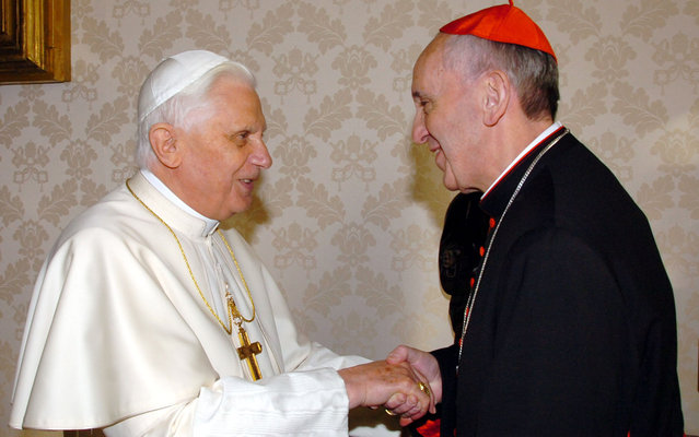 January 13, 2007 file photo provided by the Vatican newspaper L'Osservatore Romano, then Pope Benedict XVI, left, shakes hands with the archbishop of Buenos Aires Cardinal Jorge Mario Bergoglio during their meeting at the Vatican, Saturday, January 13, 2007. Bergoglio, who took the name of Pope Francis,  was elected on Wednesday, March 13, 2013 the 266th pontiff of the Roman Catholic Church. (Photo by L'Osservatore Romano/AP Photo)