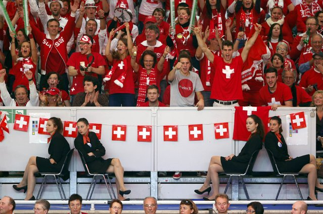 Switzerland supporters cheer on Roger Federer as he faces France's Richard Gasquet during their Davis Cup final singles tennis match at the Pierre-Mauroy stadium in Villeneuve d'Ascq, near Lille, November 23, 2014. Roger Federer beat Richard Gasquet on Sunday to give Switzerland their first Davis Cup title with a 3-1 victory over hosts France in the final. (Photo by Charles Platiau/Reuters)