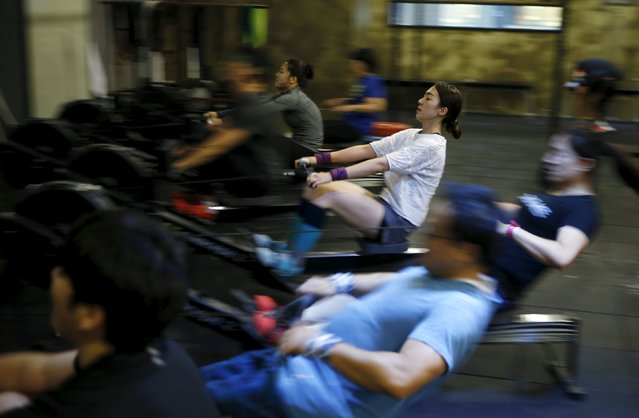 You Ri-seul (in white), 29, takes part in a crossfit class at a gym in Seoul, September 11, 2015. (Photo by Kim Hong-Ji/Reuters)