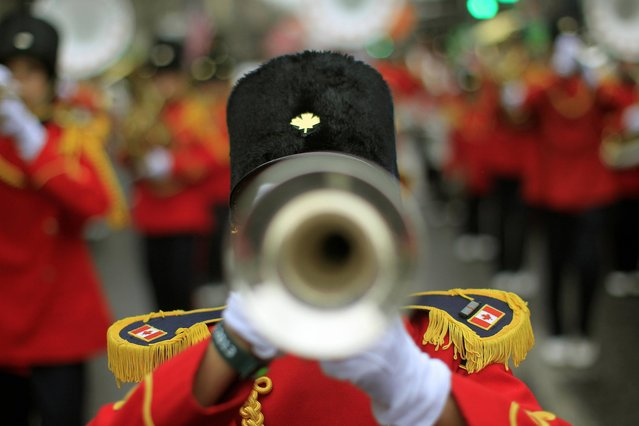 A Canadian marching band joins revellers during the St Patrick's day parade through Dublin city centre on St Patrick's day, on March 17, 2013. (Photo by Julien Behal/PA Wire)