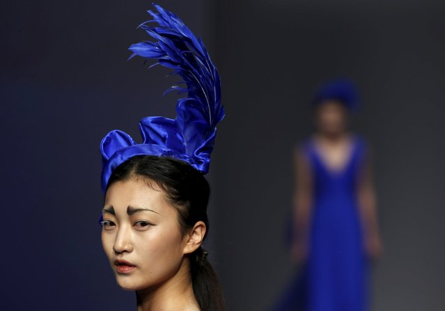 Models present creations from ECHO CHEN Collection at China Fashion Week S/S 2016 in Beijing, October 26, 2015. (Photo by Kim Kyung-Hoon/Reuters)