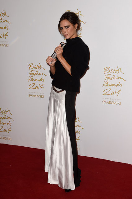 Brand winner Victoria Beckham poses in the winners room at the British Fashion Awards at London Coliseum on December 1, 2014 in London, England. (Photo by Pascal Le Segretain/Getty Images)
