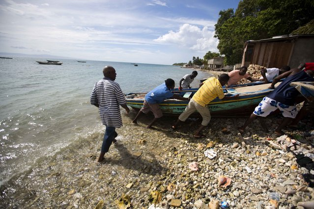 Fishermen move their boats out of the water before the arrival of Hurricane Matthew in Arcahaie, Haiti. Sunday October 2, 2016. (Photo by Dieu Nalio Chery/AP Photo)