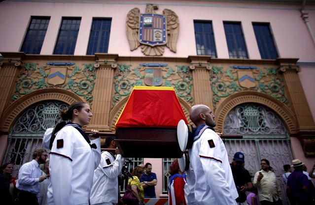 Spanish Navy sailors carry a wooden box, draped with the Spanish flag, containing the bones of Ramon Power y Giralt, on April 6, 2013. Power, the son of an Irish immigrant and a Puerto Rican woman, grew up to join the Spanish navy and helped seize what is now the Dominican Republic back from French forces led by Napoleon Bonaparte. Power died in 1813 at age 37 from yellow fever, and he was buried with several other officials in a common grave in Spain. (Photo by Ricardo Arduengo/Associated Press)