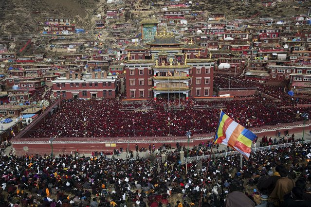 Thousands of monks, nuns and believers gather at a Buddhist laymen lodge attending a daily chanting session during the Utmost Bliss Dharma Assembly, the last of the four Dharma assemblies at Larung Wuming Buddhist Institute in remote Sertar county, Garze Tibetan Autonomous Prefecture, Sichuan province, China early October 30, 2015. (Photo by Damir Sagolj/Reuters)
