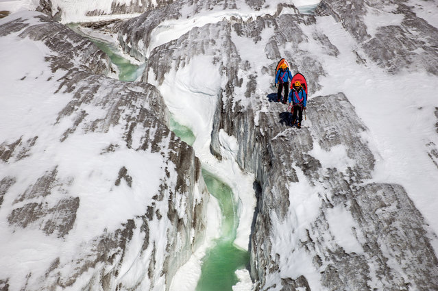 Hydrospeeding through the glacier in Switzerland. (Photo by David Carlier/Caters News)