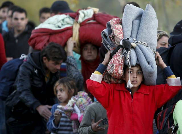 Migrants wait to enter  a transit camp in Gevgelija , Macedonia, after entering the country by crossing the border with Greece, November 9,2015. (Photo by Ognen Teofilovski/Reuters)