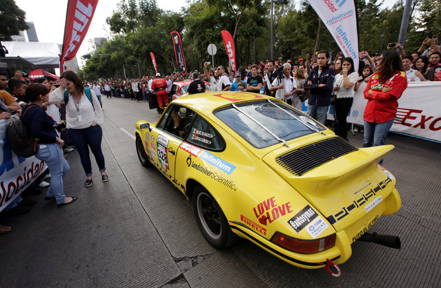 "A participant drives his 1973 Porsche 911 as he arrives in Mexico City to take part in the Carrera Panamericana (""Pan-American Road Race"") in Mexico October 15, 2016. (Photo by Henry Romero/Reuters)"