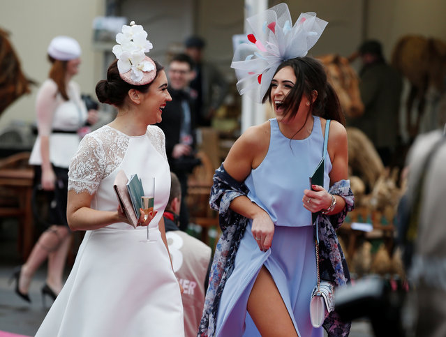 Racegoers arrive for Ladies Day at the Grand National Festival at Aintree Racecourse on April 13, 2018 in Liverpool, England. (Photo by Darren Staples/Reuters)