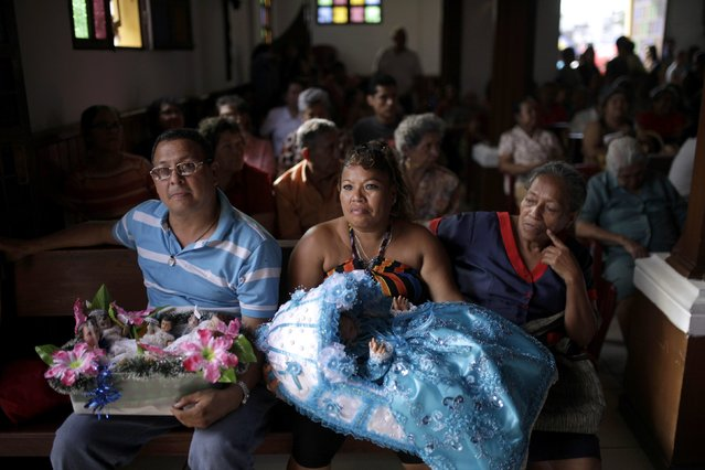 Catholics hold figurines of baby Jesus during a religious procession on Holy Innocents Day in Antiguo Cuscatlan, on the outskirts of San Salvador, December 28, 2014. (Photo by Jose Cabezas/Reuters)