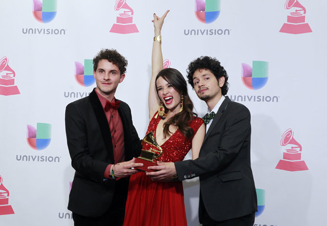 Musical group Monsieur Perine poses backstage with their award for Best New Artist at the 2015 Latin Grammy Awards in Las Vegas, Nevada November 19, 2015. (Photo by Steve Marcus/Reuters)
