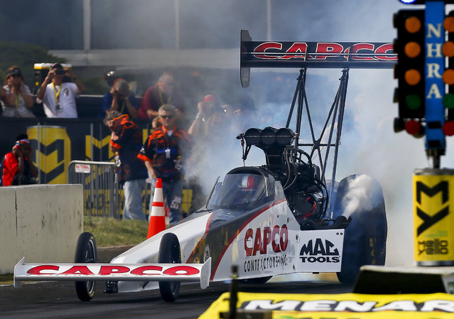 NHRA Top Fuel driver Steve Torrence burns out prior to making his first qualifying run during the Menards NHRA Heartland Nationals on Friday, May 18, 2018, at Heartland Motorsports Park in Topeka, Kan. Torrence ended the night as the top qualifier. (Photo by Chris Neal/The Capital-Journal via AP Photo)