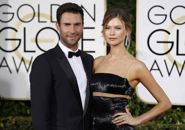 Maroon 5 singer Adam Levine (L) arrives with his wife model Behati Prinsloo at the 72nd Golden Globe Awards in Beverly Hills, California January 11, 2015. (Photo by Mario Anzuoni/Reuters)