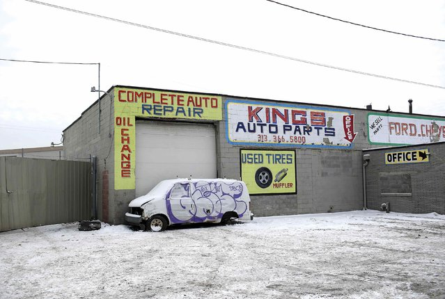 A Chevrolet Astro Van with graffiti displayed on the side sits parked outside Kings Auto Parts in Detroit, Michigan January 10, 2015. (Photo by Joshua Lott/Reuters)