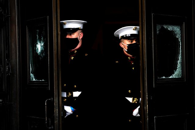 White House Marine sentries are seen during a dress rehearsal for U.S. President-elect Joe Biden's Presidential Inauguration at the U.S. Capitol, in Washington, U.S., January 18, 2021. (Photo by Melina Mara/Pool via Reuters)