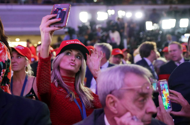 A woman takes a selfie during Republican presidential nominee Donald Trump's election night event at the New York Hilton Midtown on November 8, 2016 in New York City. Americans today will choose between Republican presidential nominee Donald Trump and Democratic presidential nominee Hillary Clinton as they go to the polls to vote for the next president of the United States.  (Photo by Chip Somodevilla/Getty Images)