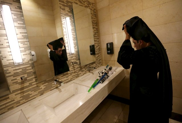 """A man adjusts his costume as a character from Star Wars in the bathroom during an event held for the release of the film """"Star Wars: The Force Awakens"""" at a movie theater in Guatemala City, December 16, 2015. (Photo by Jorge Dan Lopez/Reuters)"""