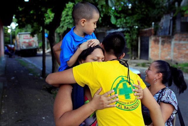 Rescuer Irving Altamirano embraces his mother, Claudia, as she visits him at the Comandos de Salvamento base in San Salvador, El Salvador August 17, 2016. Claudia is a former member of the Comandos de Salvamento. (Photo by Jose Cabezas/Reuters)