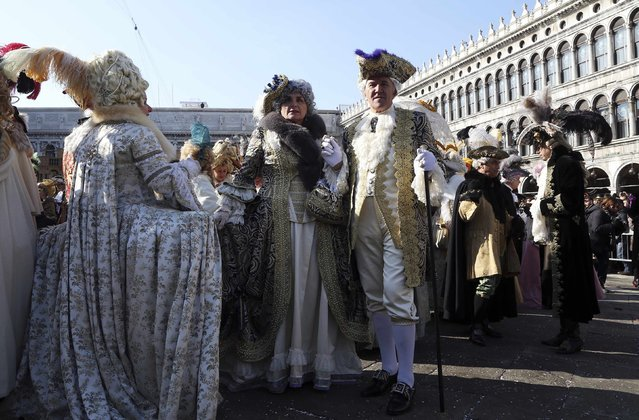 Revellers pose in Saint Mark square during carnival in Venice February 8, 2015. (Photo by Stefano Rellandini/Reuters)