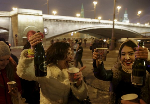 Revellers celebrate New Year's Day in central Moscow, Russia, January 1, 2016. (Photo by Tatyana Makeyeva/Reuters)