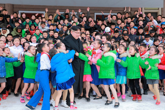 North Korean leader Kim Jong Un is hugged by children during his visit to Samjiyon County in this undated photo released by North Korea's Korean Central News Agency (KCNA) in Pyongyang November 28, 2016. (Photo by Reuters/KCNA)