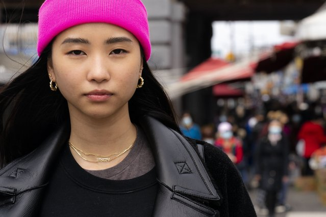 """Teresa Ting stands for a portrait, Wednesday, March 31, 2021, in the Flushing neighborhood of the Queens borough of New York. The vicious assault of a 65-year-old woman while walking to church this week near New York City's Times Square has heightened already palpable levels of outrage over anti-Asian attacks that started with the pandemic. Ting, a 29-year-old Chinese American, started what has become the Main Street Patrol following an attack on another older Asian American woman in February. """"It literally could have been my mother had it been the wrong place, wrong time"""", Ting said of that attack. (Photo by John Minchillo/AP Photo)"""