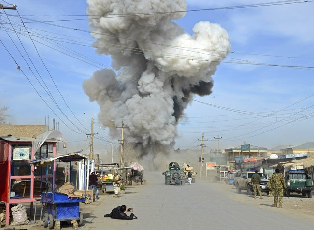 Smoke rises in the sky after a suicide car bomb attack in Kunduz province February 10, 2015. Taliban insurgents launched an attack on a police headquarters in northern Afghanistan, provincial police spokesman Sayed Sarwar Hosseini said. At least two policemen were wounded in the attack, and five suicide attackers were killed by Afghan forces, Hosseini reported. (Photo by Reuters/Stringer)