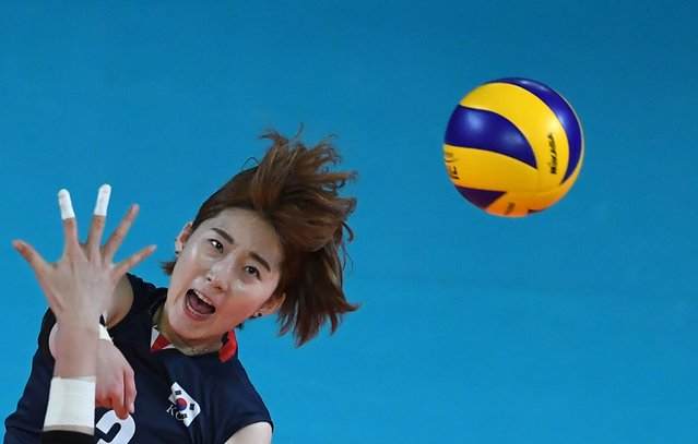South Korea's Jung Ho-young spikes the ball against China during their women's group B preliminary volleyball match between South Korea and China at the 2018 Asian Games in Jakarta on August 23, 2018. (Photo by Punit Paranjpe/AFP Photo)