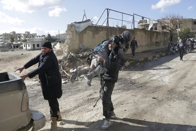A man carries an injured woman in a site hit by what activists said were airstrikes carried out by the Russian air force in the rebel-controlled area of Maaret al-Numan town in Idlib province, Syria January 9, 2016. (Photo by Khalil Ashawi/Reuters)