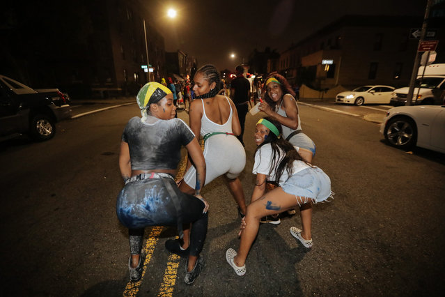 Revelers participate in J'Ouvert, an overnight celebration the night before the West Indies Day Parade in Brooklyn, NY on September 3, 2018. (Photo by Stephen Yang)
