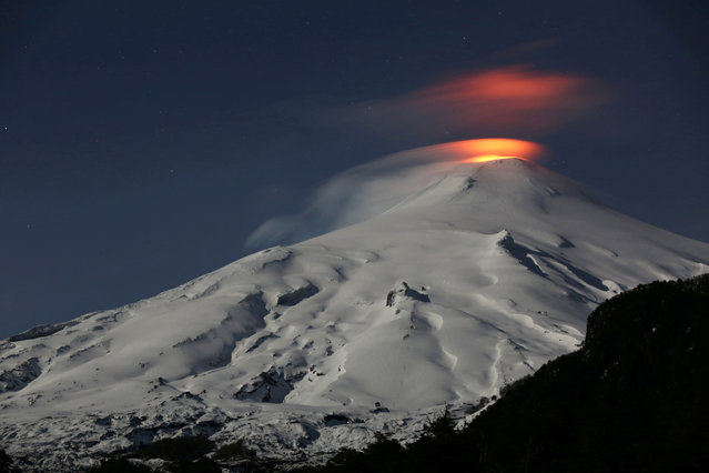 The Villarrica Volcano is seen at night from Pucon town, Chile, September 24, 2018. (Photo by Cristobal Saavedra Escobar/Reuters)