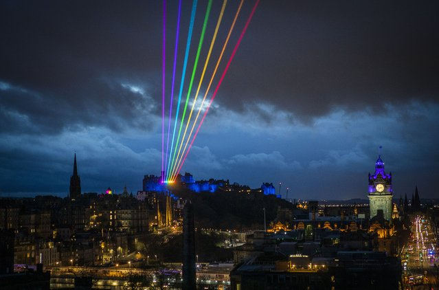 A rainbow lights up the Edinburgh skyline during the Scottish premiere of Global Rainbow a laser art installation by Yvette Mattern, part of Burns and Beyond, Edinburgh's flagship Burns festival on Wednesday March 24, 2021. (Photo by Jane Barlow/PA Images via Getty Images)