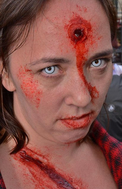 A participant dressed as a zombie pictured during the World Zombie Day event in London. (Photo by Dave Evans/Demotix/Corbis)