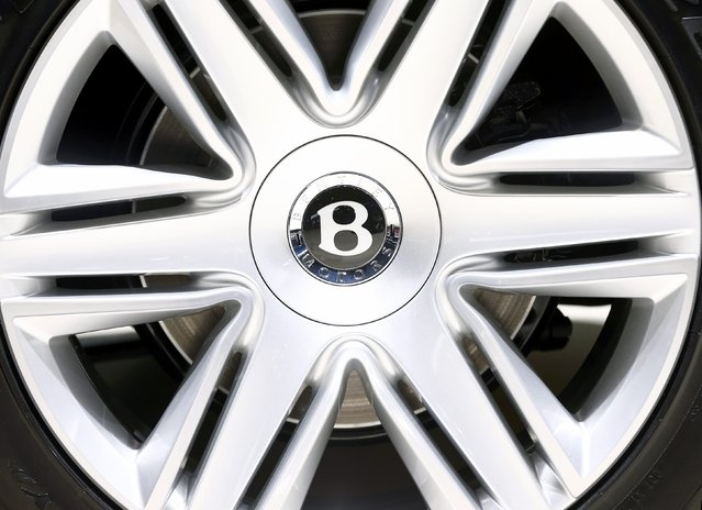 The wheel hub of a Bentley Continental GT convertible car is seen during the second press day ahead of the 85th International Motor Show in Geneva March 4, 2015. REUTERS/Arnd Wiegmann