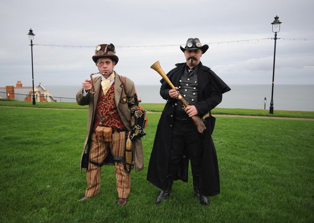 Chris Simpson (L), and Wayne Ellis, both from Chesterfield visit the Goth weekend dressed as steampunks on November 2, 2013 in Whitby, England. The Whitby Gothic Weekend that takes place in the Yorkshire seaside town twice yearly in Spring and Autumn started in 1994 and sees thousands of extravagantly dressed followers of Victoriana, Steampunk, Cybergoth and Romanticism visit to take part in celebrating Gothic culture. (Photo by Ian Forsyth/Getty Images)