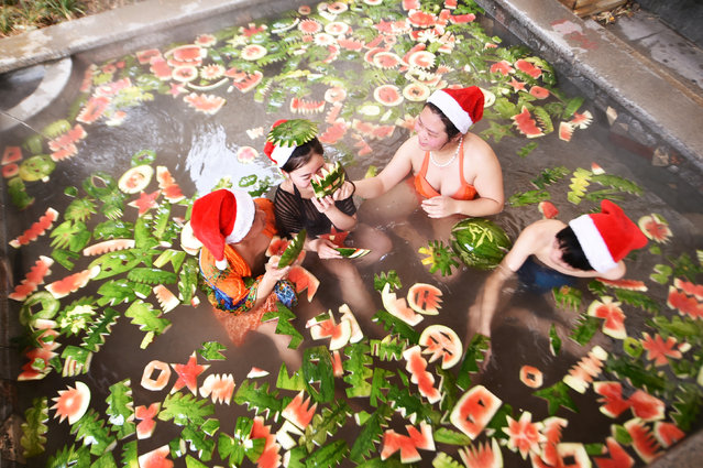 People wearing Christmas hats bath in a pool of watermelon peel during a Christmas service at a hot spring in Luoyang, Henan province, China, December 24, 2016. (Photo by Reuters/Stringer)