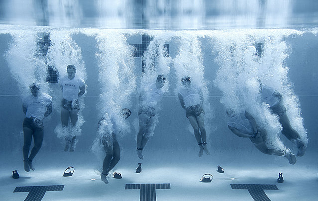 Members of the Special Tactics Training Squadron enter the pool with their hands and feet bound. The drown proofing exercise teaches students to remain calm in the water during stressful situations, skills that are vital during real-world operations. (Photo by Master Sgt. Jeffrey Allen/U.S. Air Force)