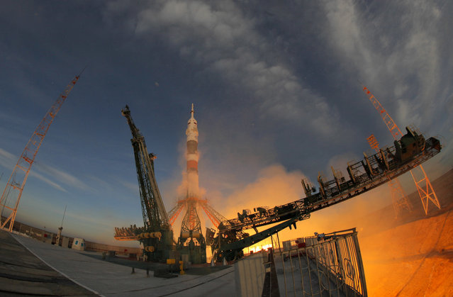 The Soyuz-FG rocket booster with Soyuz MS-11 space ship carrying a new crew to the International Space Station, ISS, blasts off at the Russian leased Baikonur cosmodrome, Kazakhstan, Monday, December 3, 2018. The Russian rocket carries U.S. astronaut Anne McClain, Russian cosmonaut Оleg Kononenko and CSA astronaut David Saint Jacques. (Photo by Dmitri Lovetsky/AP Photo)