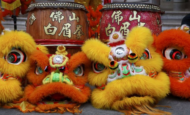 Masks and drums used by members of the Pak Mei DE Lao Wei San Kung-Fu school used to celebrate Chinese New Year are seen in front of the Shangri-La hotel in Paris, France, February 8, 2016. (Photo by Jacky Naegelen/Reuters)