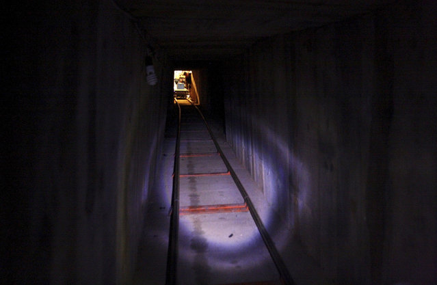 A soldier looks into a tunnel found under the Mexico-U.S. border in Tijuana, November 30, 2011. (Photo by Jorge Duenes/Reuters)