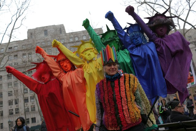 Pat Oleszko, 73, wears her costume representing women of all colors with the Statues of Libery behind her, at the Women's Unity Rally in Foley Square, Manhattan in New York City, New York, U.S., January 19, 2019. (Photo by Gabriela Bhaskar/Reuters)