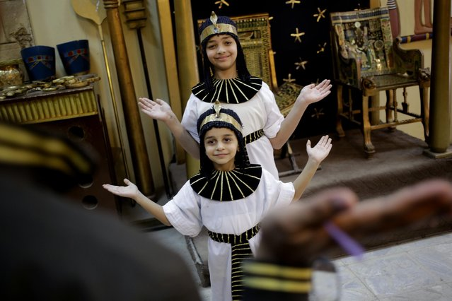 "Egyptian children wearing Pharaonic costumes pose for a photograph at the studio of the Pharaonic Village, during Sham el-Nessim, or ""smelling the breeze"", in Giza, Egypt, Monday, April 13, 2015. (Photo by Amr Nabil/AP Photo)"