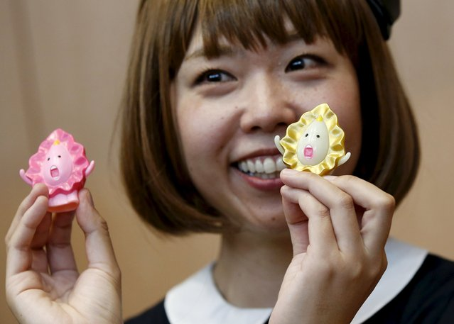 Japanese artist Megumi Igarashi, known as Rokudenashiko, holds her v*gina-inspired artworks after a news conference following a court appearance in Tokyo April 15, 2015. (Photo by Toru Hanai/Reuters)
