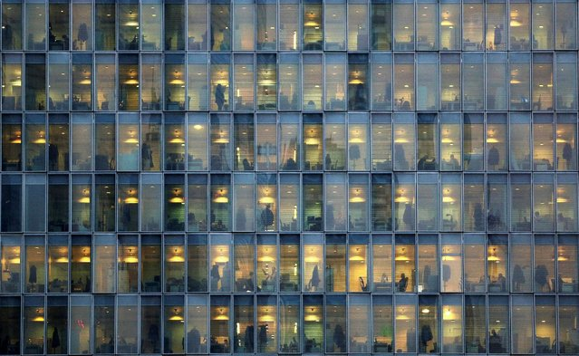 Lights are on as people work in an office building in Milan, Italy, February 17, 2015. (Photo by Stefano Rellandini/Reuters)