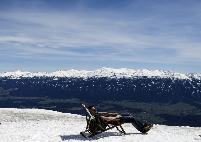 A man lies on a sun chair on a sunny spring day at Seegrube mountain in Innsbruck April 15, 2015. (Photo by Dominic Ebenbichler/Reuters)