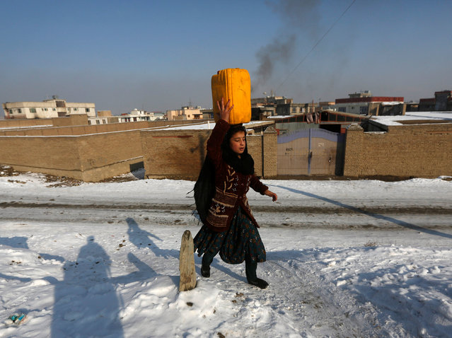 A girl carries a water container on her head in Kabul, Afghanistan January 16, 2017. (Photo by Omar Sobhani/Reuters)