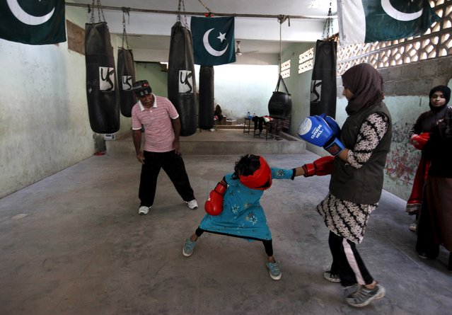 Arisha, 9, punches Misbah during an exercise session at the first women's boxing coaching camp in Karachi, Pakistan February 20, 2016. (Photo by Akhtar Soomro/Reuters)