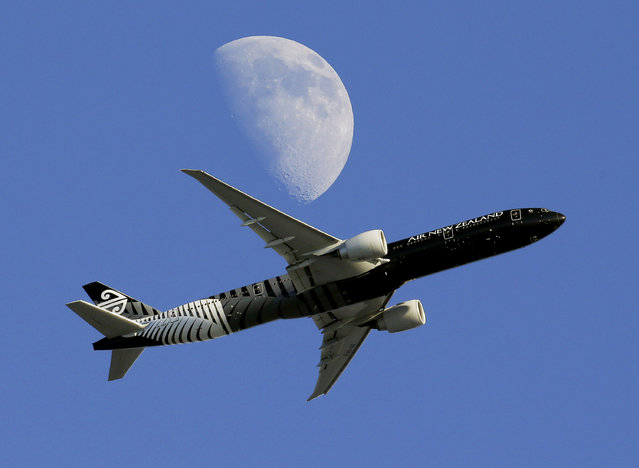 In this August 23, 2015, file photo, an Air New Zealand passenger plane flies past the moon on its way to the Los Angeles International Airport from London, in Whittier, Calif. Air New Zealand said a drone came within meters of a flight descending into Auckland Airport from Tokyo, putting the safety of 278 passengers and crew at risk. The national carrier is calling for prison terms for drone operators who endanger lives after the incident Sunday, March 25, 2018. (Photo by Nick Ut/AP Photo)