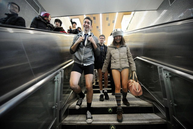 People take part in a 'No Pants Subway Ride' event in Beijing on January 12, 2014. Commuters in Hong Kong and Beijing braved public transport without trousers in the stunt, also celebrated in Australia's major cities, which has gone global since its first staging by the US group Improv Everywhere in New York in 2002. (Photo by Wang Zhao/AFP Photo)