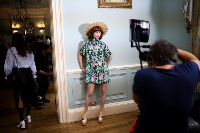 Models prepare backstage ahead of the Paul & Joe catwalk show at London Fashion Week in London, Britain, September 20, 2021. (Photo by Henry Nicholls/Reuters)